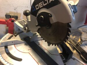 miter saw blade keeps spinning