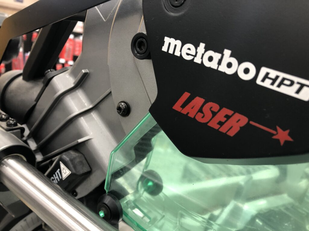 Miter saw with a laser guide